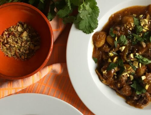 Spice rubbed pork stew with orange, beans & onions